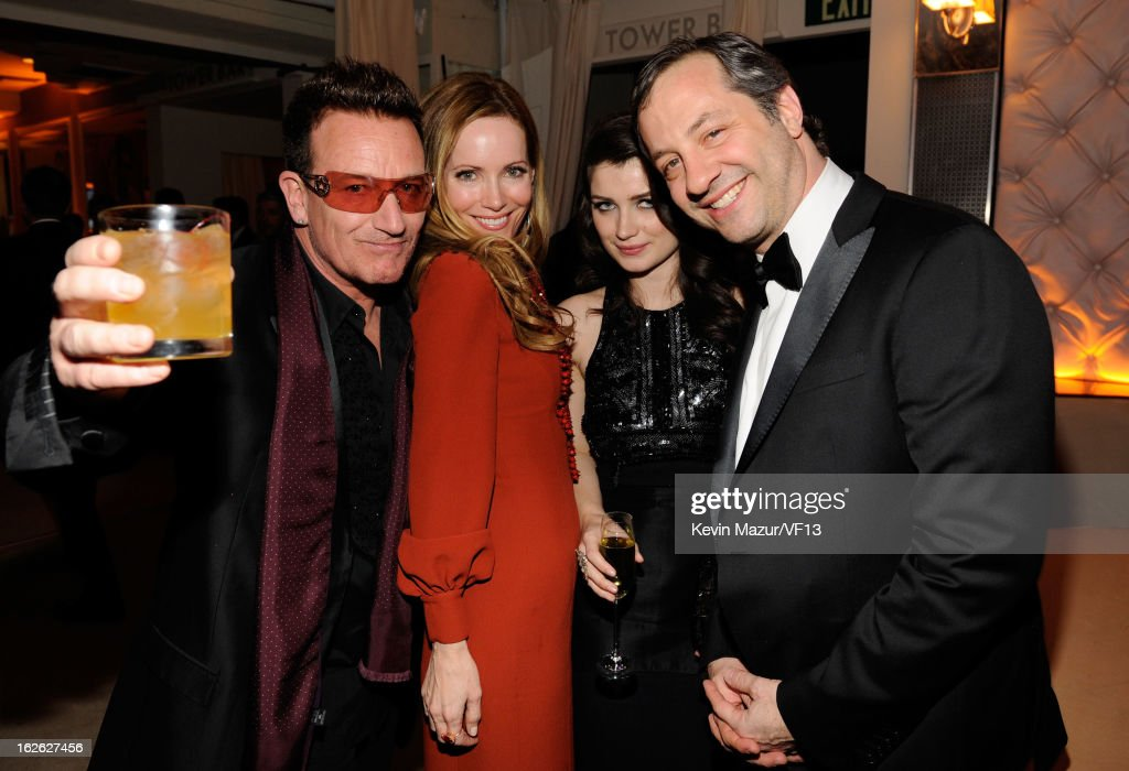 Singer Bono, actress Eve Hewson, actress Leslie Mann, and director Judd Apatow attends the 2013 Vanity Fair Oscar Party hosted by Graydon Carter at Sunset Tower on February 24, 2013 in West Hollywood, California.