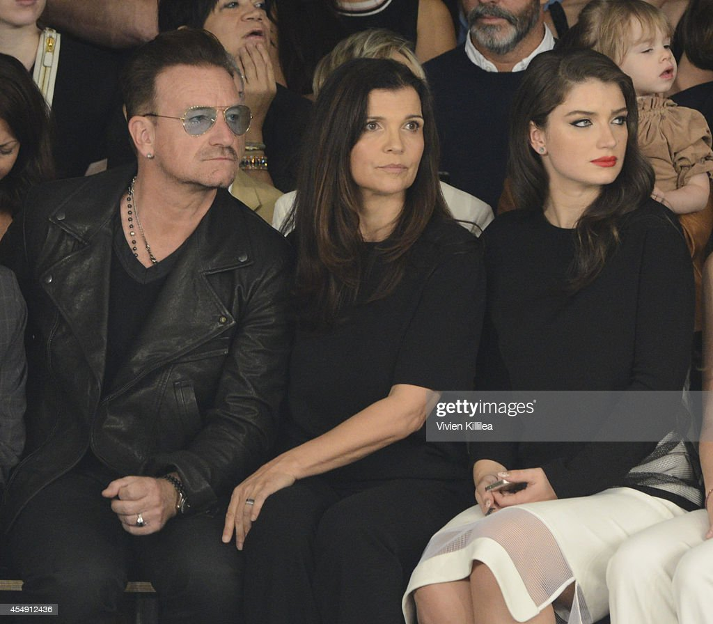 Singer <a gi-track='captionPersonalityLinkClicked' href=/galleries/search?phrase=Bono+-+Singer&family=editorial&specificpeople=167279 ng-click='$event.stopPropagation()'>Bono</a>, <a gi-track='captionPersonalityLinkClicked' href=/galleries/search?phrase=Ali+Hewson&family=editorial&specificpeople=210576 ng-click='$event.stopPropagation()'>Ali Hewson</a> and <a gi-track='captionPersonalityLinkClicked' href=/galleries/search?phrase=Eve+Hewson&family=editorial&specificpeople=5294973 ng-click='$event.stopPropagation()'>Eve Hewson</a> attend the Edun fashion show during Mercedes-Benz Fashion Week Spring 2015 at Skylight Modern on September 7, 2014 in New York City.