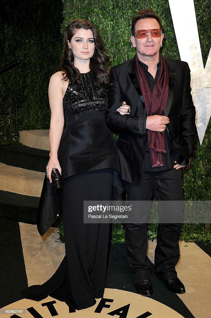Singer Bono (R) and actress Eve Hewson arrive at the 2013 Vanity Fair Oscar Party hosted by Graydon Carter at Sunset Tower on February 24, 2013 in West Hollywood, California.