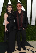 Singer Bono and actress Eve Hewson arrive at the 2013 Vanity Fair Oscar Party hosted by Graydon Carter at Sunset Tower on February 24 2013 in West...