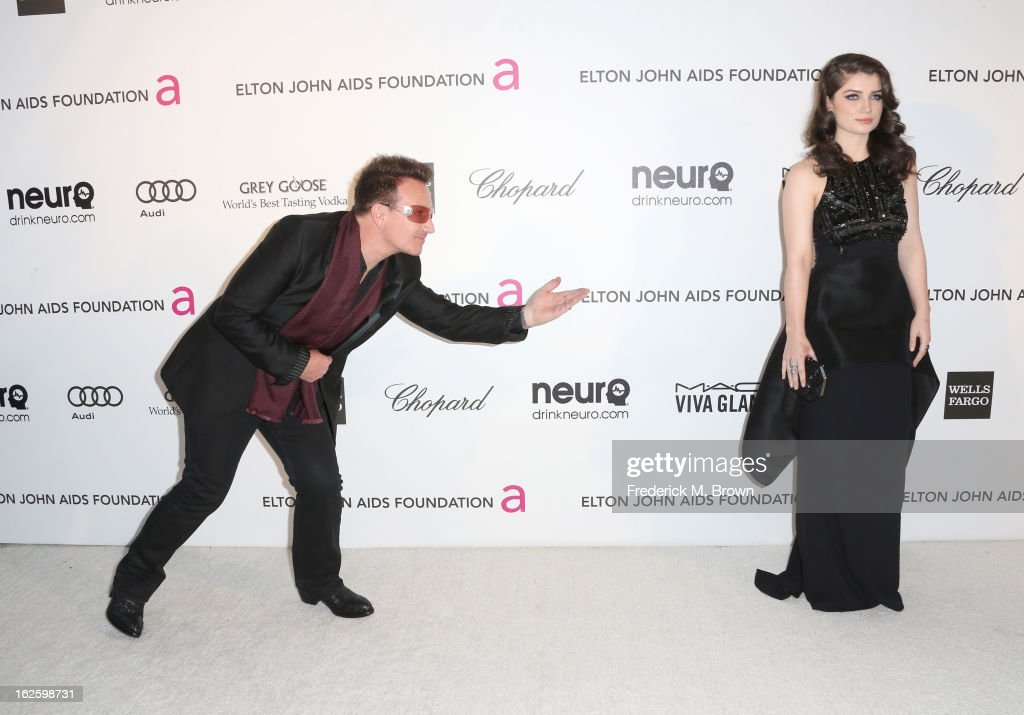 Singer Bono and Actress Eve Hewson arrives at the 21st Annual Elton John AIDS Foundation's Oscar Viewing Party on February 24, 2013 in Los Angeles, California.