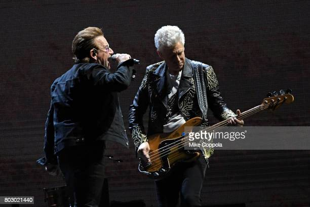Singer Bono and Bass player Adam Clayton of the band U2 perform during U2 'Joshua Tree Tour 2017' at MetLife Stadium on June 28 2017 in East...