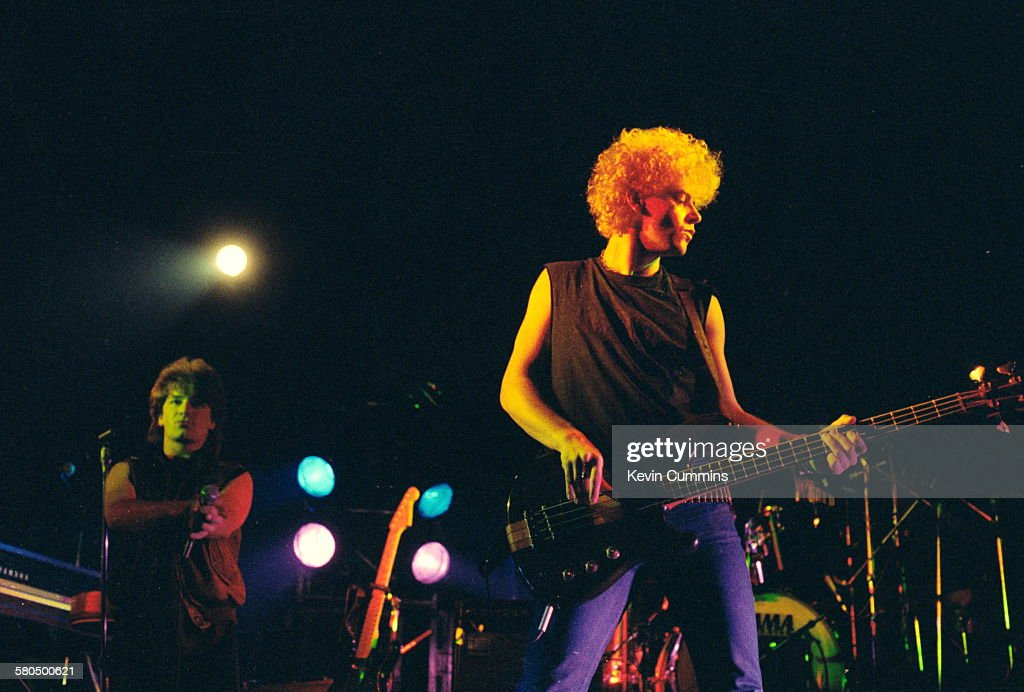 Singer Bono and bassist Adam Clayton performing with Irish rock group U2 at the Manchester Apollo December 1982