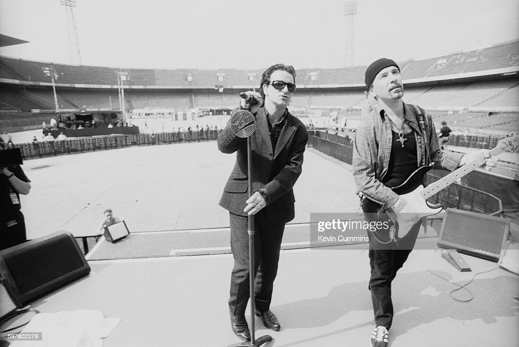 Singer Bono and guitarist The Edge of Irish rock group U2 at a soundcheck at Feijenoord Stadion Rotterdam during the band's Zoo TV tour 11th May 1993