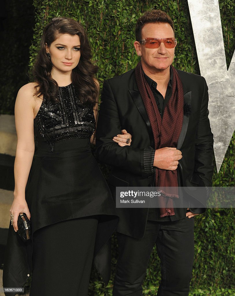 Singer Bono (R) and his daughter actress Eve Hewson arrive at the 2013 Vanity Fair Oscar Party at Sunset Tower on February 24, 2013 in West Hollywood, California.