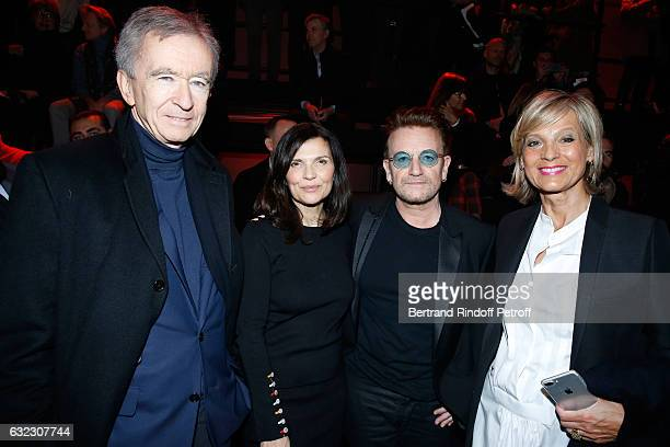 Singer Bono and his wife Ali Hewson standing between Owner of LVMH Luxury Group Bernard Arnault and his wife Helene Arnault attend the Dior Homme...