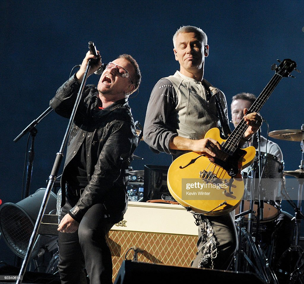Singer Bono and musician Adam Clayton of U2 perform onstage during their '360 Degrees Tour' at the Rose Bowl on October 25 2009 in Pasadena California