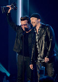 Singer Bono and musician The Edge of U2 accept the Innovator Award onstage at the iHeartRadio Music Awards which broadcasted live on TBS TNT AND...