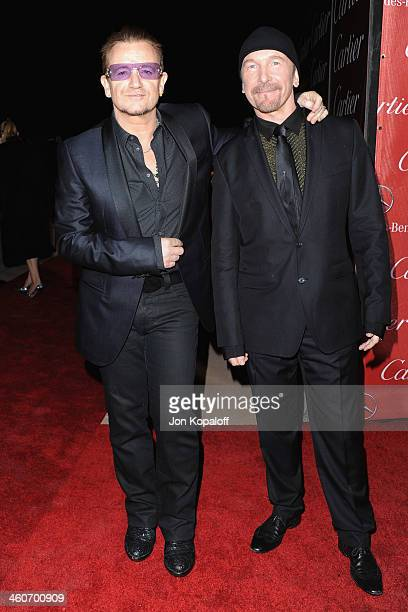 Singer Bono and musician The Edge of U2 arrive at the 25th Annual Palm Springs International Film Festival Awards Gala at Palm Springs Convention...