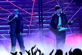 Singer Bono and musician The Edge of U2 perform onstage during Fox's 'American Idol 2011' finale results show held at Nokia Theatre LA Live on May 25...