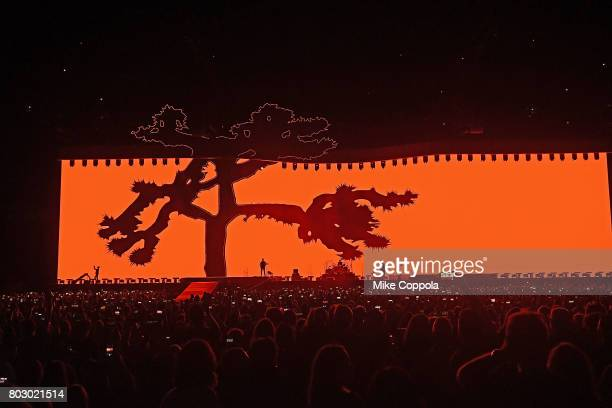 Singer Bono Guitar player The Edge Drummer Larry Mullen Jr and Bass player Adam Clayton of the band U2 perform during U2 'Joshua Tree Tour 2017' at...
