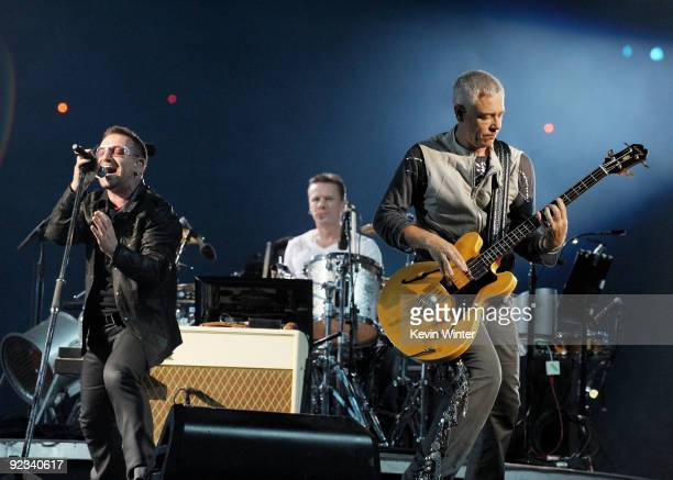 Singer Bono musicians Larry Mullens Jr and Adam Clayton of U2 perform onstage during their '360 Degrees Tour' at the Rose Bowl on October 25 2009 in...
