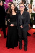 Singer Bono of U2 and Alison Hewson attend the 71st Annual Golden Globe Awards held at The Beverly Hilton Hotel on January 12 2014 in Beverly Hills...