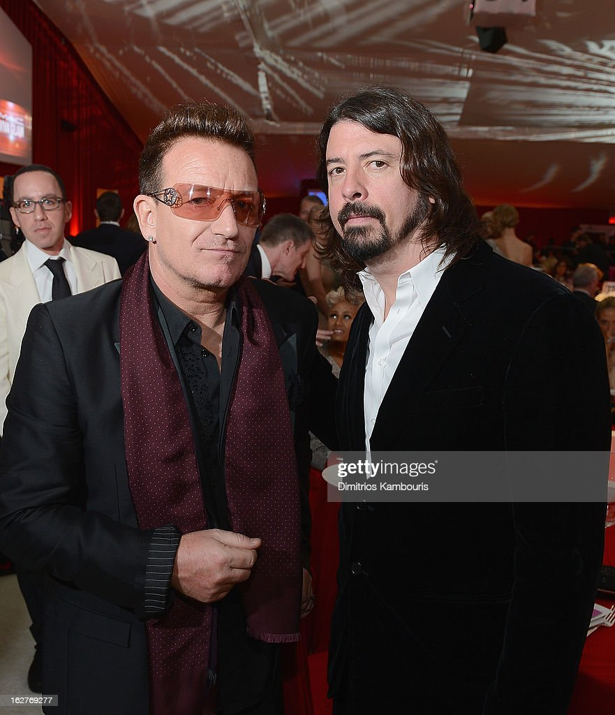Singer <a gi-track='captionPersonalityLinkClicked' href=/galleries/search?phrase=Bono&family=editorial&specificpeople=167279 ng-click='$event.stopPropagation()'>Bono</a> of U2 and musician <a gi-track='captionPersonalityLinkClicked' href=/galleries/search?phrase=Dave+Grohl&family=editorial&specificpeople=202539 ng-click='$event.stopPropagation()'>Dave Grohl</a> attend the 21st Annual Elton John AIDS Foundation Academy Awards Viewing Party at West Hollywood Park on February 24, 2013 in West Hollywood, California.