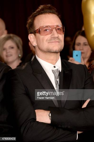 Singer Bono of U2 attends the Oscars held at Hollywood Highland Center on March 2 2014 in Hollywood California