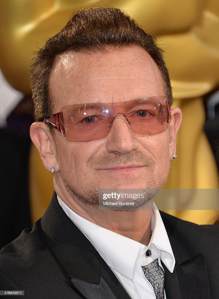 Singer <a gi-track='captionPersonalityLinkClicked' href=/galleries/search?phrase=Bono&family=editorial&specificpeople=167279 ng-click='$event.stopPropagation()'>Bono</a> of U2 attends the Oscars held at Hollywood & Highland Center on March 2, 2014 in Hollywood, California.