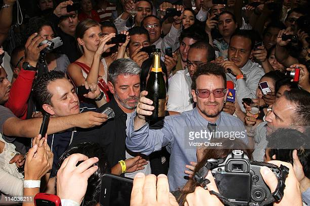 Singer Bono of U2 celebrates his 51st birthday by making a toast with fans and media outside Pujol restaurant on the streets of Masaryk in Polanco...