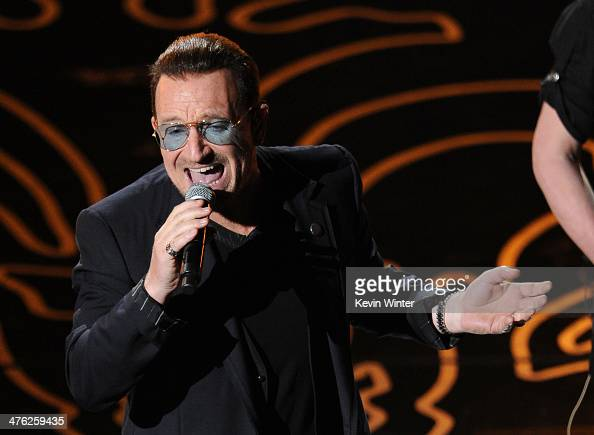 Singer Bono of U2 performs onstage during the Oscars at the Dolby Theatre on March 2 2014 in Hollywood California