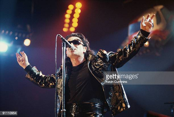 Singer Bono performing in his stage persona of 'The Fly' during a concert by Irish rock group U2 on their 'Zoo TV' tour USA 1992