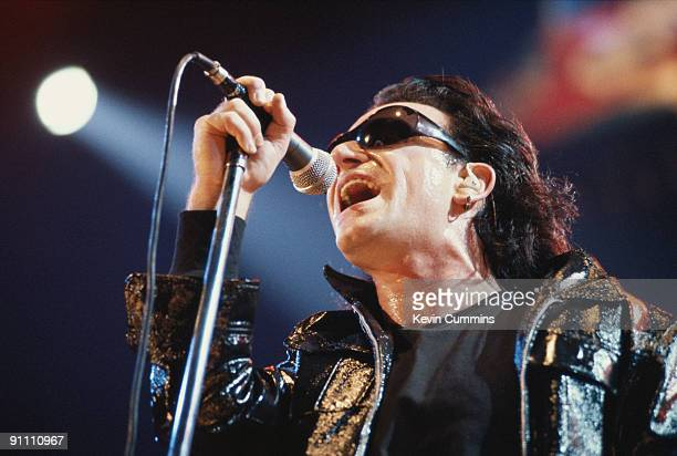 Singer Bono performing with Irish rock group U2 on their 'Zoo TV' tour 1992