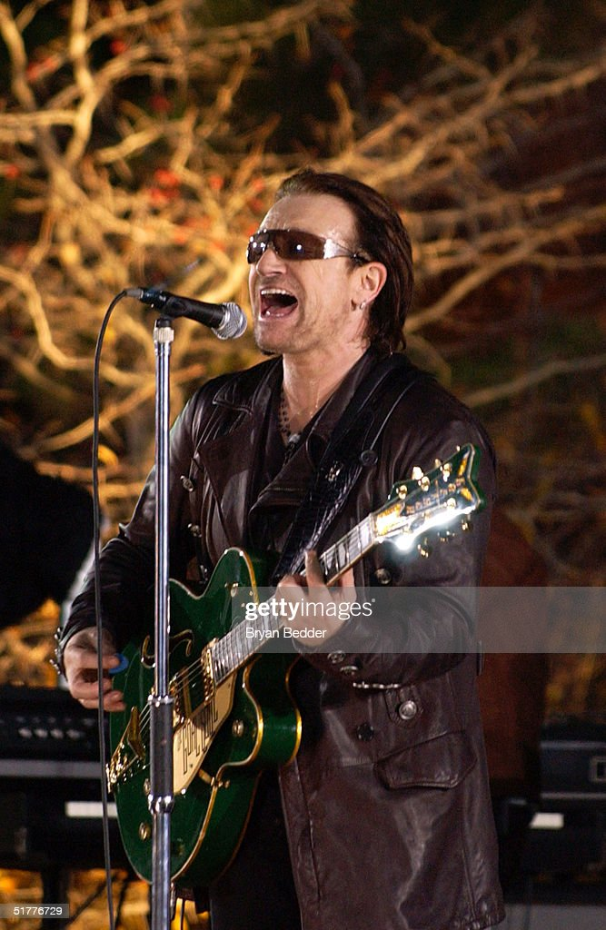 Singer Bono performs with the rock group U2 during the taping of a music video at EmpireFulton Ferry State Park November 22 2004 in the Brooklyn...