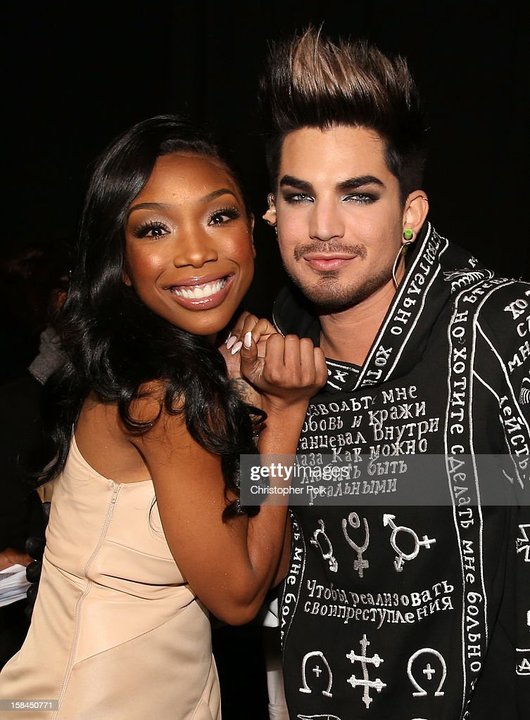 Singer Brandy and host Adam Lambert attend 'VH1 Divas' 2012 at The Shrine Auditorium on December 16, 2012 in Los Angeles, California.