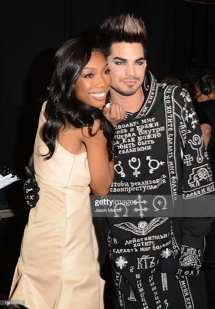 Singer Brandy (L) and host Adam Lambert attend 'VH1 Divas' 2012 held at The Shrine Auditorium on December 16, 2012 in Los Angeles, California.