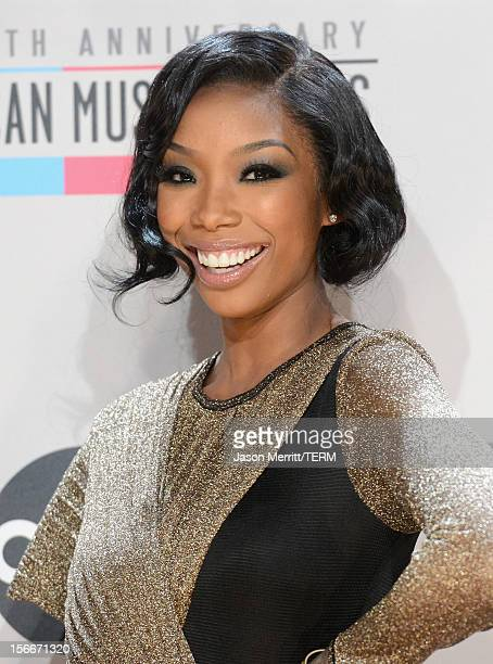 Singer Brandy poses in the press room at the 40th American Music Awards held at Nokia Theatre LA Live on November 18 2012 in Los Angeles California
