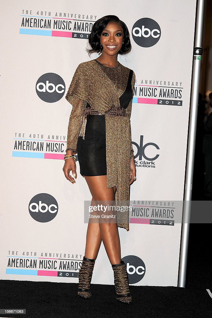 Singer Brandy poses in the press room at the 40th Anniversary American Music Awards held at Nokia Theatre L.A. Live on November 18, 2012 in Los Angeles, California.