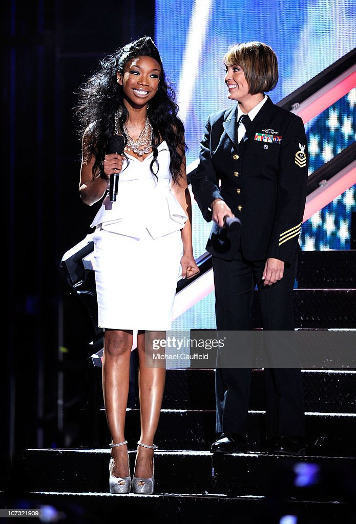 Singer Brandy speaks onstage during 'VH1 Divas Salute the Troops' presented by the USO at the MCAS Miramar on December 3, 2010 in Miramar, California. 'VH1 Divas Salute the Troops' concert event will be televised on Sunday, December 5 at 9:00 PM ET/PT on VH1.