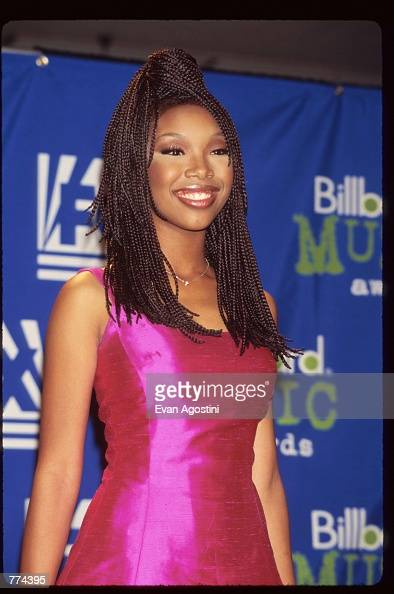 B singer Brandy stands at the 1995 Billboard Music Awards December 6 1995 in New York City The awards honor the year's number one musical artists...