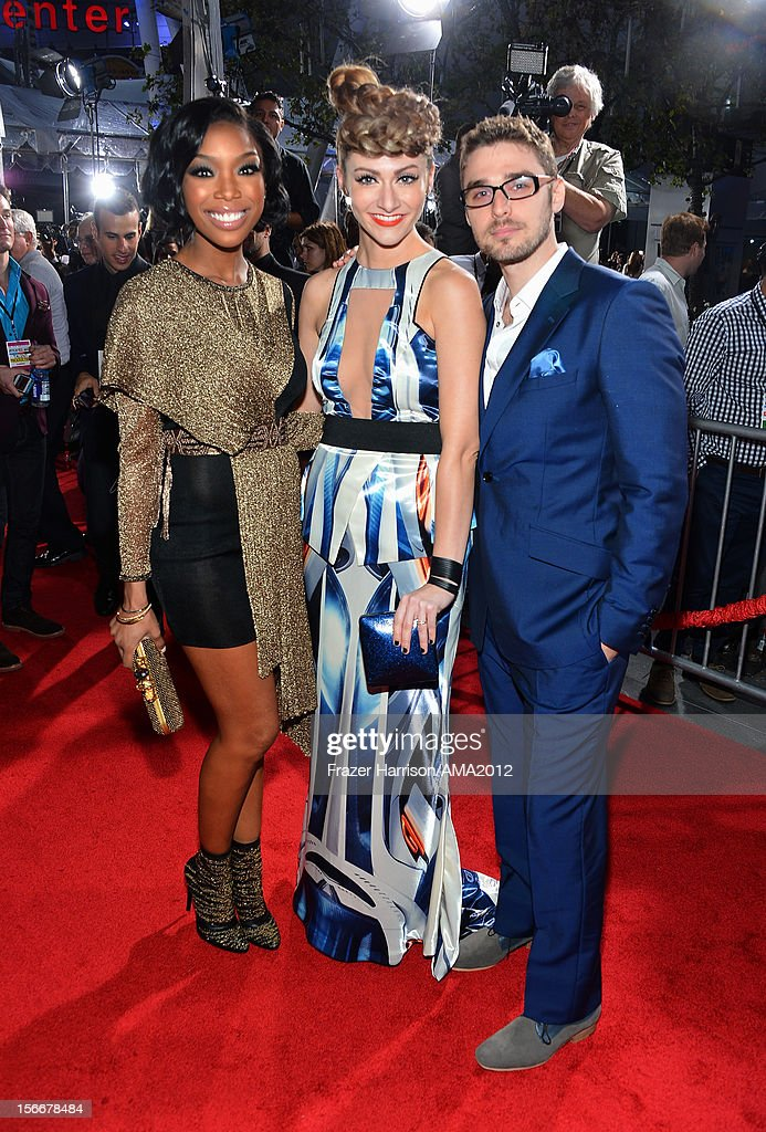 Singer Brandy (L) with singers Amy Heidemann and Nick Noonan of Karmin attend the 40th American Music Awards held at Nokia Theatre L.A. Live on November 18, 2012 in Los Angeles, California.