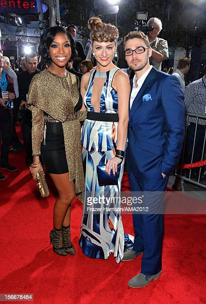 Singer Brandy with singers Amy Heidemann and Nick Noonan of Karmin attend the 40th American Music Awards held at Nokia Theatre LA Live on November 18...