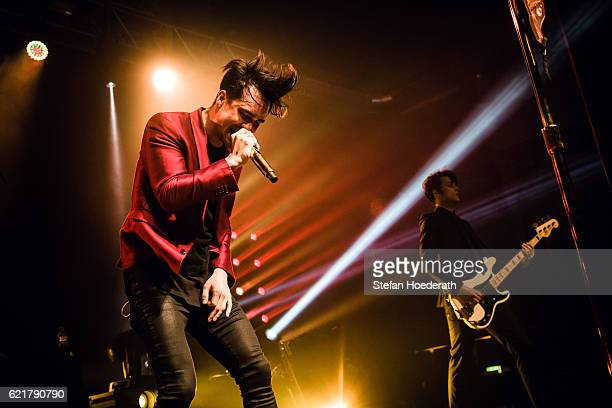 Singer Brendon Urie and bassist Dallon Weekes of Panic At The Disco perform live on stage during a concert at Huxleys Neue Welt on November 8 2016 in...