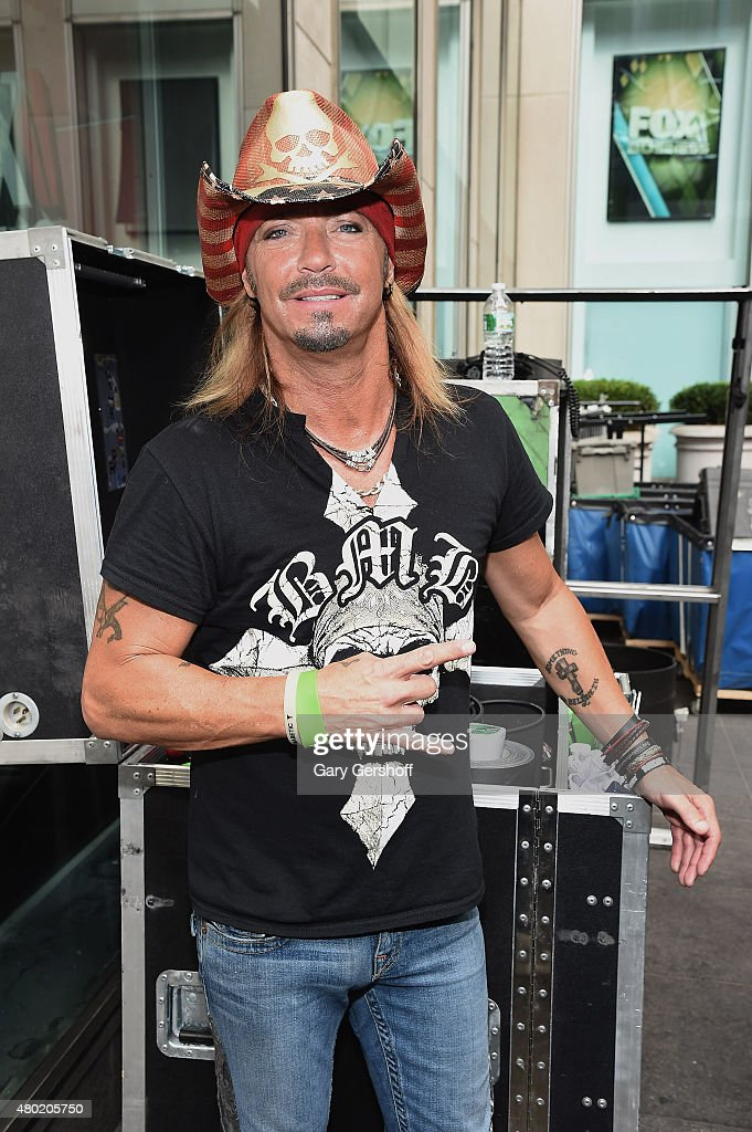Singer Bret Michaels poses for pictures backstage after performing at 'FOX & Friends' All American Concert Series outside of FOX Studios on July 10, 2015 in New York City.