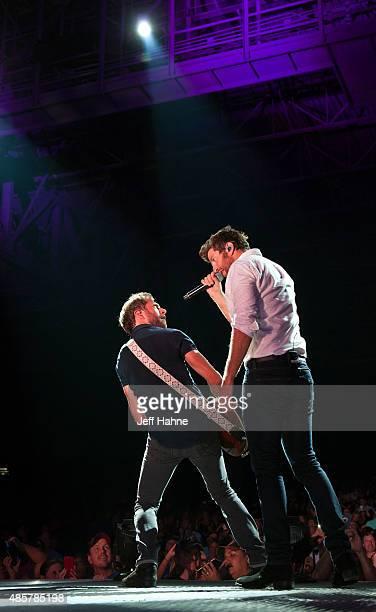 Singer Brett Eldredge and guitarist Jesse Tucker perform at PNC Music Pavilion on August 29 2015 in Charlotte North Carolina