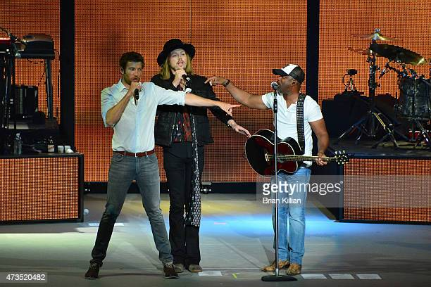 Singer Brett Eldredge Michael Hobby of A Thousand Horses and Darius Rucker perform at PNC Bank Arts Center on May 14 2015 in Holmdel New Jersey