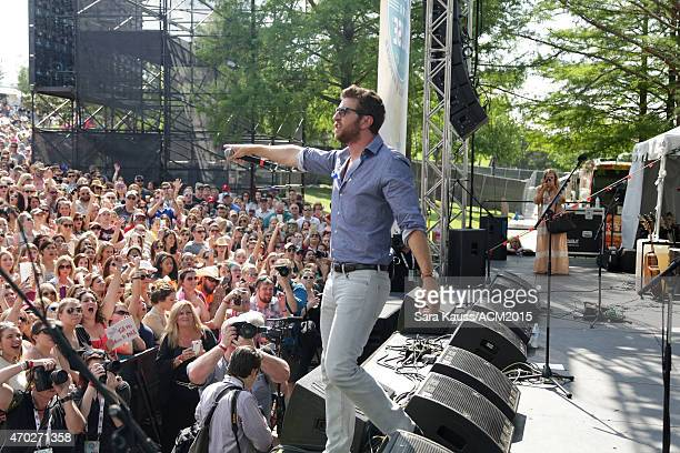 Singer Brett Eldredge performs onstage during the ACM Party For A Cause Festival at Globe Life Park in Arlington on April 18 2015 in Arlington Texas