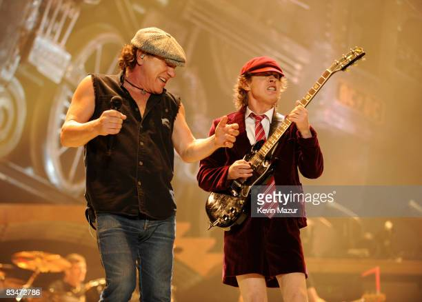 Singer Brian Johnson and Angus Young of AC/DC perform during their 'Black Ice' Tour Opener on October 28 2008 in WilkesBarre Pennsylvania