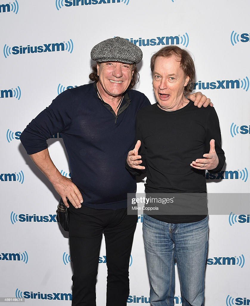 Singer <a gi-track='captionPersonalityLinkClicked' href=/galleries/search?phrase=Brian+Johnson+-+Musicista&family=editorial&specificpeople=221497 ng-click='$event.stopPropagation()'>Brian Johnson</a> (L) and guitarist <a gi-track='captionPersonalityLinkClicked' href=/galleries/search?phrase=Angus+Young&family=editorial&specificpeople=789698 ng-click='$event.stopPropagation()'>Angus Young</a> of the band AC/DC attend the SiriusXM's 'Town Hall' With AC/DC's <a gi-track='captionPersonalityLinkClicked' href=/galleries/search?phrase=Angus+Young&family=editorial&specificpeople=789698 ng-click='$event.stopPropagation()'>Angus Young</a> And <a gi-track='captionPersonalityLinkClicked' href=/galleries/search?phrase=Brian+Johnson+-+Musicista&family=editorial&specificpeople=221497 ng-click='$event.stopPropagation()'>Brian Johnson</a> on November 17, 2014 in New York City.