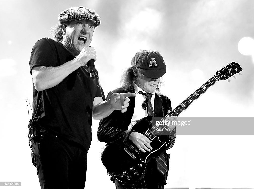 Singer Brian Johnson (L) and musician Angus Young of AC/DC perform at Dodger Stadium on September 28, 2015 in Los Angeles, California.
