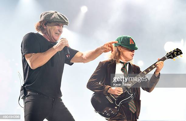 Singer Brian Johnson and musician Angus Young of AC/DC perform at Dodger Stadium on September 28 2015 in Los Angeles California