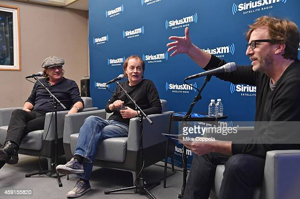 Singer Brian Johnson guitarist Angus Young of the band AC/DC and record producer Brendan O'Brien attend the SiriusXM's 'Town Hall' with AC/DC's Angus...