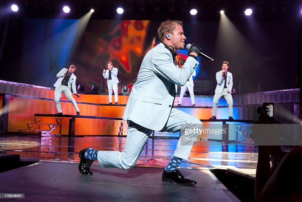 Singer <a gi-track='captionPersonalityLinkClicked' href=/galleries/search?phrase=Brian+Littrell&family=editorial&specificpeople=215310 ng-click='$event.stopPropagation()'>Brian Littrell</a> of Backstreet Boys performs at Backstreet Boys In Concert at Gibson Amphitheatre on September 4, 2013 in Universal City, California.