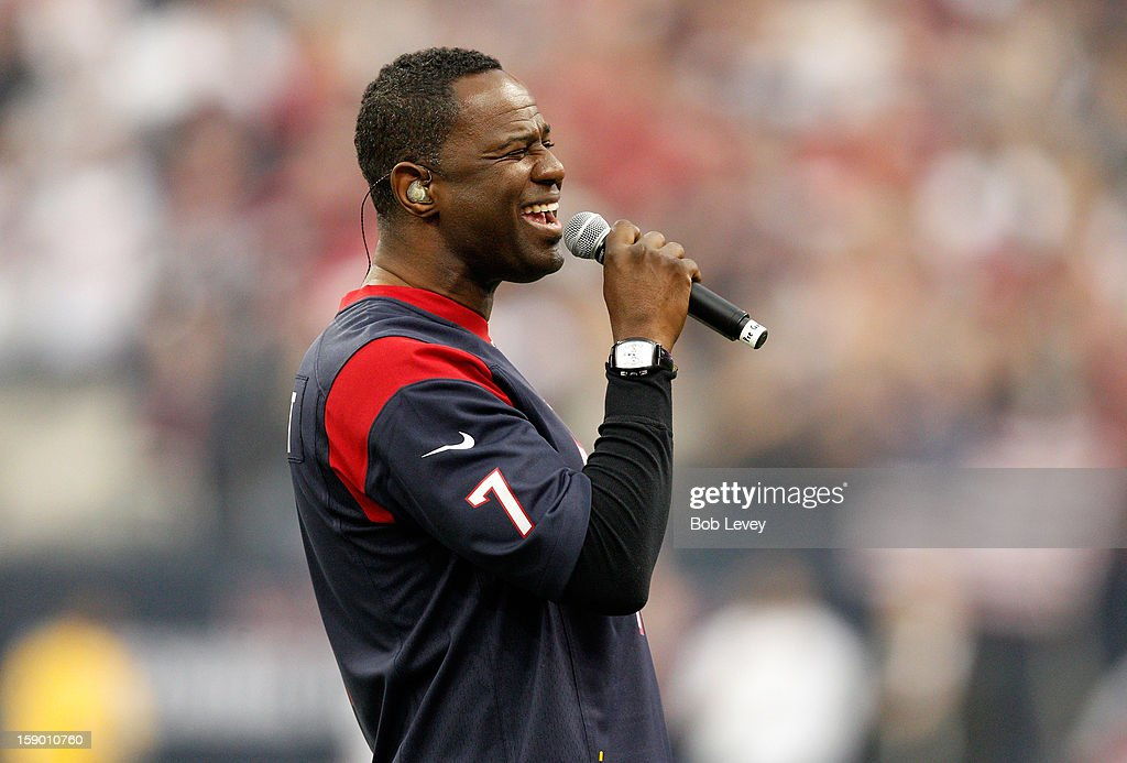Singer Brian McKnight performs the National Anthem prior to the Houston Texans hosting the Cincinnati Bengals during their AFC Wild Card Playoff Game at Reliant Stadium on January 5, 2013 in Houston, Texas.