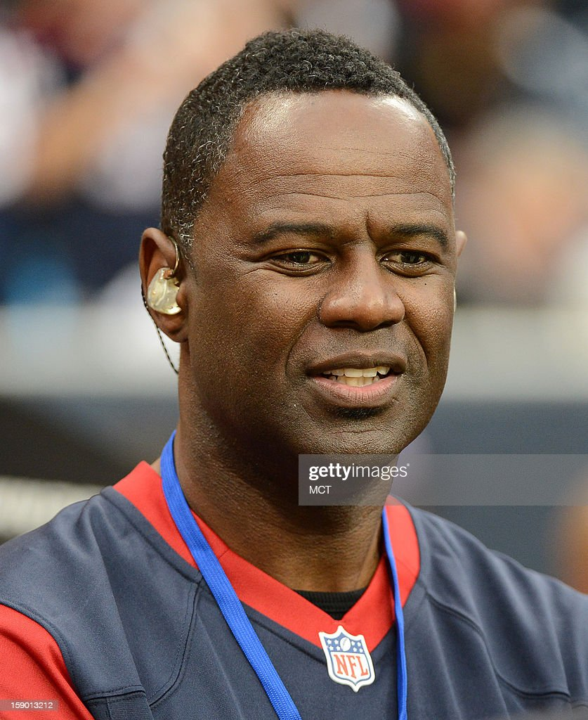 Singer Brian McKnight waits to sing the National Anthem before the Houston Texas face the Cincinnati Bengals in their AFC playoff game on Saturday, January 5, 2013, in Houston, Texas.