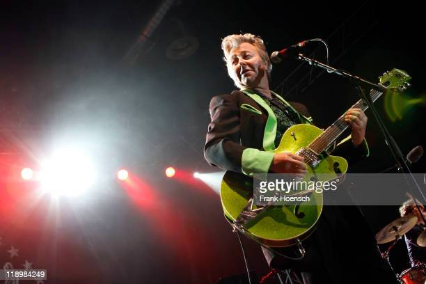Singer Brian Setzer performs live during a concert at the Huxleys on July 13 2011 in Berlin Germany
