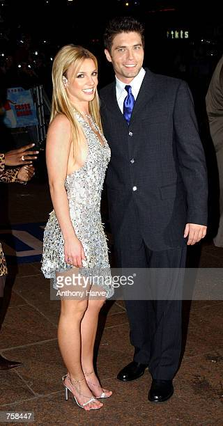 Singer Britney Spears and her costar Anson Mount arrive at the British premiere of her debut film 'Crossroads' March 25 2002 in London