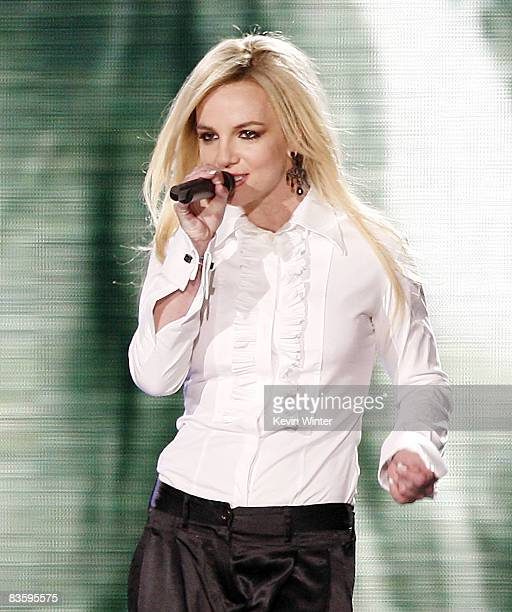 Singer Britney Spears appears onstage to perform with singer Madonna during her Sticky and Sweet Tour at Dodger Stadium on November 6 2008 in Los...