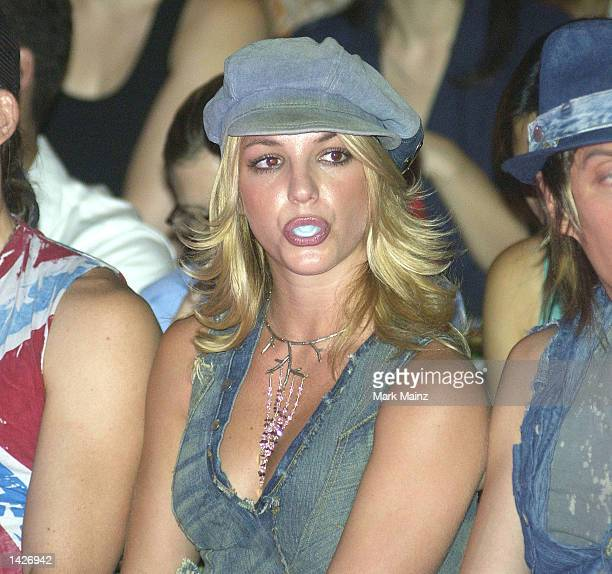Singer Britney Spears blows bubbles with her bubble gum during the House of Field Spring/Summer 2003 Collection at the New York Public Library during...